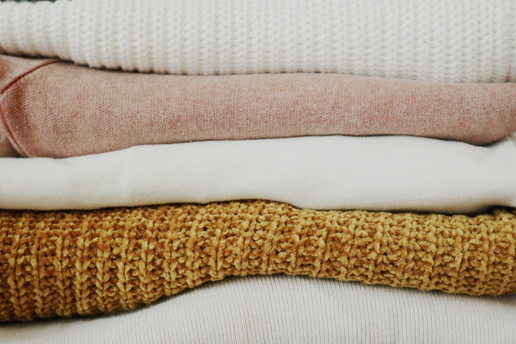 organic linen folded on a bed